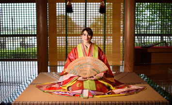Woman posing in kimono with fan