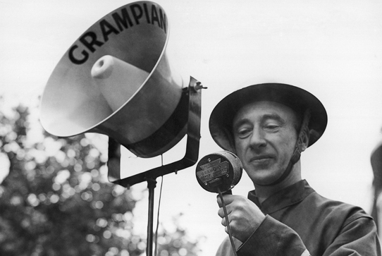 Air raid warden with microphone