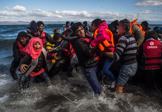 Group of refugees struggling to get on shore